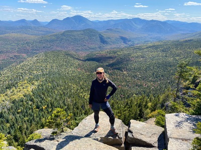 Andrea Zelinski stands on Zealand Mountain in New Hampshire during her seven-month hike on the Appalachian Trail.