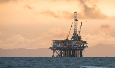 Photo of an off-shore oil rig near
