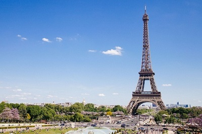 Photo of the Eiffel Tower surrounded by the city of Paris
