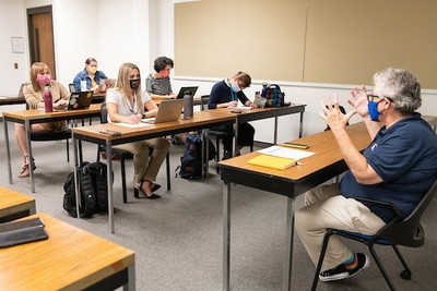 Interim Chancellor Karen Whitney participating in a mock press conference with Public Affairs Reporting students Wednesday, September 15, 2021.
