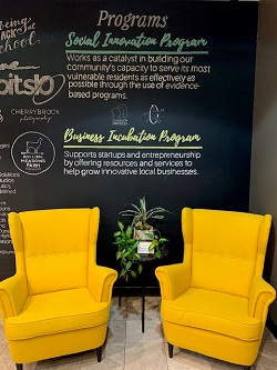 Photo of two chairs in the Innovate Springfield offices in front of a Social Innovation sign
