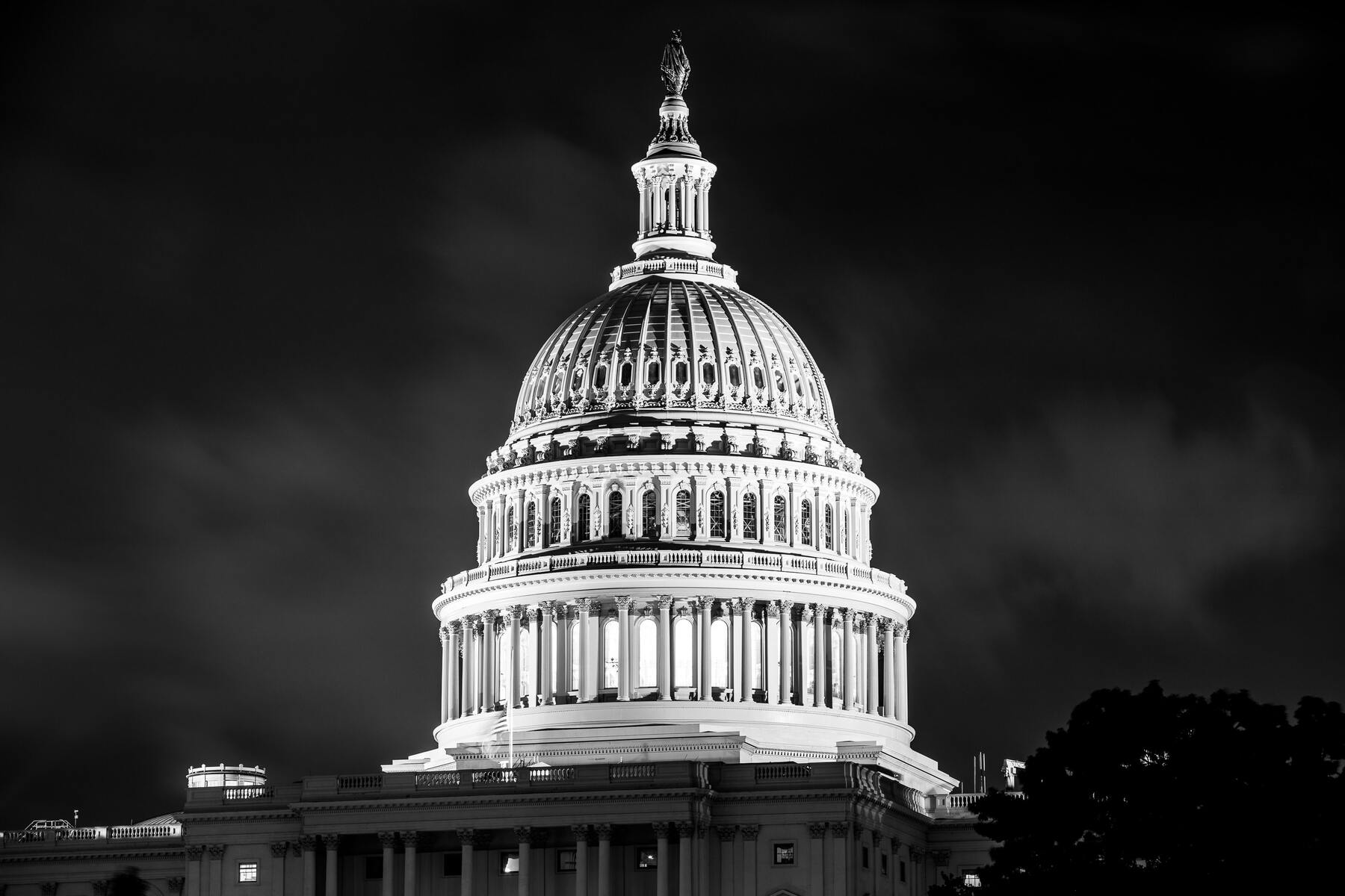 Black and white image of the U.S. Capitol dome at night