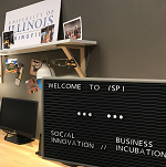 "Sign with ""Welcome to iSPI.  Social Innovation.  Business Incubation"" in front of desk at the Innovate Springfield office"